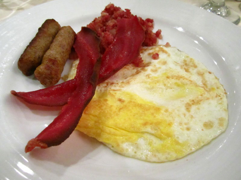 Charming Similar As Yesterday: Over Well Fried Eggs With Turkey Bacon And Some  Sausages And Corned Beef.