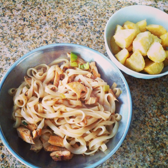 Homemade stir fry rice noodles with chicken and roasted potatoes